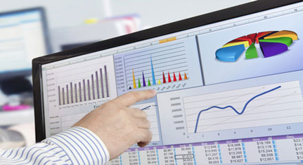 hand pointing to data on a screen
