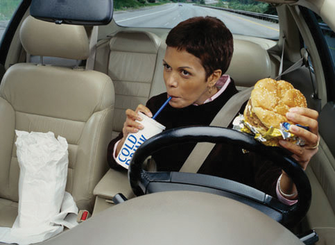 A person driving while eating